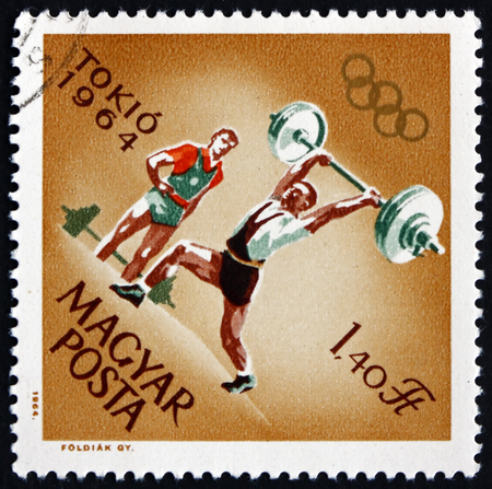 HUNGARY - CIRCA 1964: a stamp printed in Hungary shows Weight Lifting, 18th Olympic Games, Tokyo, circa 1964 Editorial