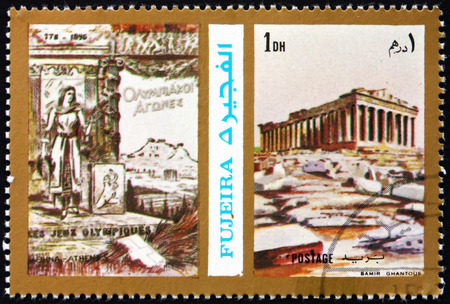 FUJEIRA - CIRCA 1972: a stamp printed in the Fujeira shows Poster of Athens 1896 Olympics, Acropolis, circa 1972