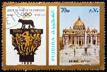 FUJEIRA - CIRCA 1972: a stamp printed in the Fujeira shows Poster of Rome 1960 Olympics, St. Peter�s Basilica, circa 1972