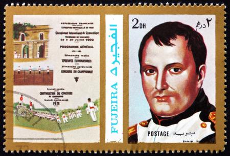 napoleon i: FUJEIRA - CIRCA 1972: a stamp printed in the Fujeira shows Poster of Paris 1900 Olympics, Napoleon I, circa 1972