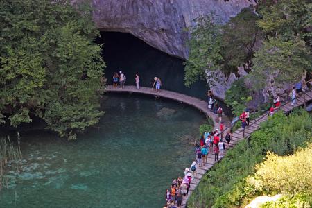 walk path: CROATIA PLITVICE, 16 JULY 2011: Tourists walk on a path in Plitvice Lakes National Park, Croatia