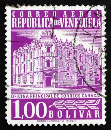 VENEZUELA - CIRCA 1958: a stamp printed in the Venezuela shows Main Post Office, Caracas, circa 1958 新聞圖片