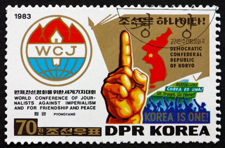 NORTH KOREA - CIRCA 1983: a stamp printed in North Korea shows Emblem, Map, Hand with Raised Forefinger, circa 1983 Editorial