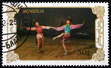 MONGOLIA - CIRCA 1990: a stamp printed in Mongolia shows Dancers in Scene from Ballet, Mongolian Ballet, circa 1990 Editorial