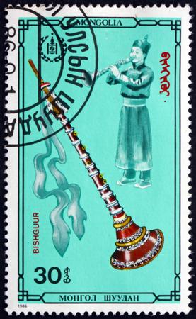 MONGOLIA - CIRCA 1986: a stamp printed in Mongolia shows Bishguur, Mongolian Musical Instrument, circa 1986