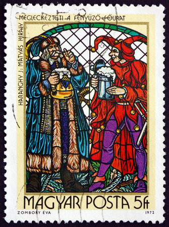 HUNGARY - CIRCA 1972: a stamp printed in Hungary shows King Matthias and Jester, Stained-glass Window by Jeno Haranghy, circa 1972 Editorial