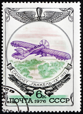 RUSSIA - CIRCA 1976: a stamp printed in the Russia shows Gakkel IX, 1912, Russian Aircraft and Russian Aviation Emblem, circa 1976 Editorial