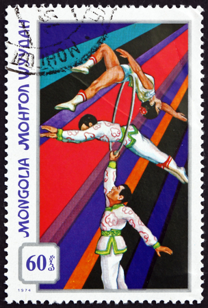MONGOLIA - CIRCA 1974: a stamp printed in Mongolia shows Acrobats with Ring, Mongolian Circus, circa 1974
