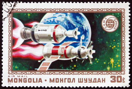 MONGOLIA - CIRCA 1975: a stamp printed in Mongolia shows Apollo, Soyuz and Earth, Apollo Soyuz Space Test Project, Space Cooperation, circa 1975