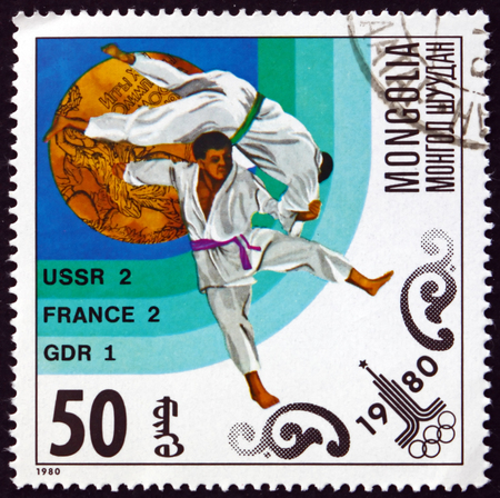 MONGOLIA - CIRCA 1980: a stamp printed in Mongolia shows Judo, Gold Medal and Number of Medals Won by Top Countries, Moscow '80, circa 1980 Editorial