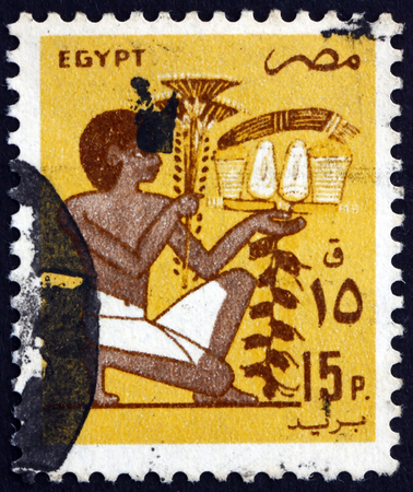 EGYPT - CIRCA 1985: a stamp printed in Egypt shows Slave Bearing Votive Fruit Offering, Mural, circa 1985