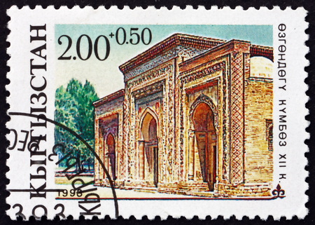 KYRGYZSTAN - CIRCA 1993: a stamp printed in the Kyrgyzstan shows Mausoleum in Uzgen, Architectural Monument, XII Century, circa 1993 Editorial