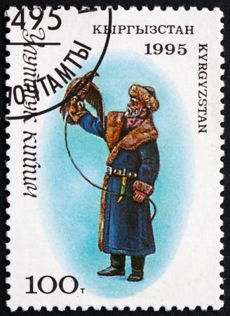 KYRGYZSTAN - CIRCA 1995: a stamp printed in the Kyrgyzstan shows Man in Traditional Kyrgyz Costume with a Falcon, circa 1995 Editorial