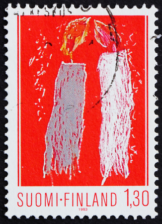 FINLAND - CIRCA 1983: a stamp printed in Finland shows two candles, childrens drawing, circa 1983
