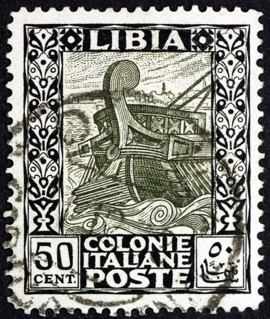 LIBYA - CIRCA 1921: a stamp printed in Libya shows ancient galley leaving Tripoli, circa 1921 Editorial
