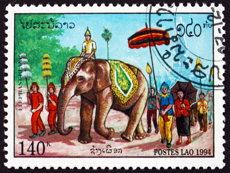 LAOS - CIRCA 1994: a stamp printed in Laos shows elephant in the procession, circa 1994 Editorial