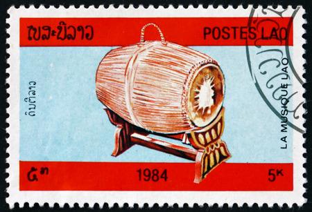 LAOS - CIRCA 1984: a stamp printed in Laos shows barrel drum, musical instrument, circa 1984