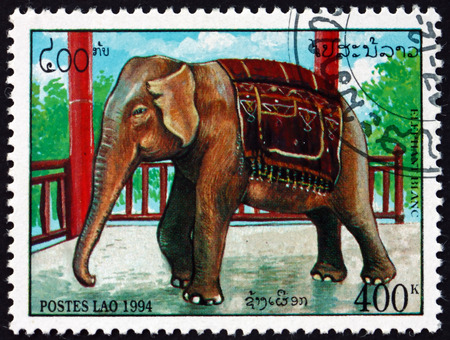 LAOS - CIRCA 1994: a stamp printed in Laos shows elephant beside railing, circa 1994