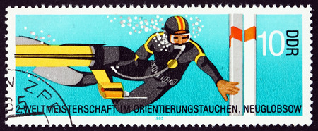 GERMANY - CIRCA 1985: a stamp printed in Germany shows Diver at Turning Buoy, 2nd World Orienteering and Deep-sea Diving Championship, circa 1985