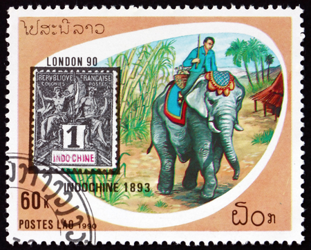 LAOS - CIRCA 1990: a stamp printed in Laos shows elephant, Indo-China, mode of mail transport, circa 1990