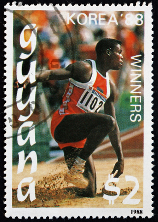 GUYANA - CIRCA 1988: a stamp printed in Guyana shows Carl Lewis, jumping, 1988 Summer Olympics, Korea, circa 1988