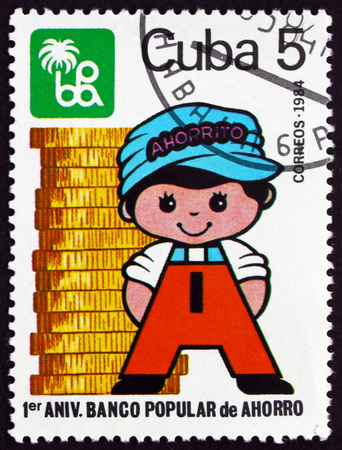 CUBA - CIRCA 1984: a stamp printed in Cuba dedicated to Banco Popular de Ahorro, 1st anniversary, circa 1984 Redakční