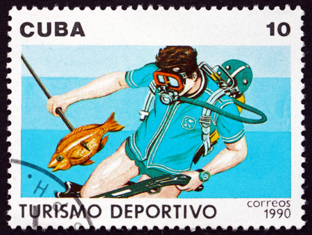 CUBA - CIRCA 1990: a stamp printed in Cuba shows spear fishing, tourism, circa 1990