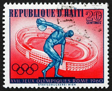HAITI - CIRCA 1960: a stamp printed in Haiti shows discus thrower and Rome stadium, 17th Olympic games, Rome, circa 1960