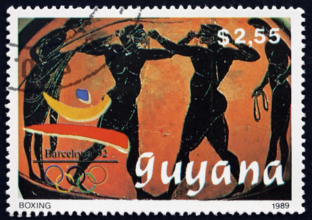 GUYANA - CIRCA 1989: a stamp printed in Guyana shows boxing, 1992 Summer Olympics, Barcelona, circa 1989 Editorial