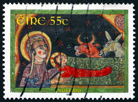 IRELAND - CIRCA 2009: A stamp printed in Ireland shows Nativity, illustration from the Gospel Book, Gamaghiel Monastery, Khizan, Christmas, circa 2009 Editorial