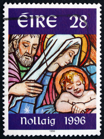 IRELAND - CIRCA 1996: A stamp printed in Ireland shows image of Holy family in stained glass, Christmas, circa 1996