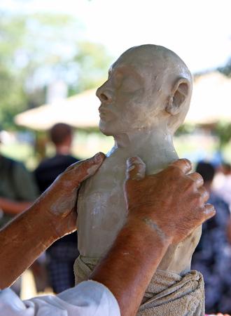 CROATIA KOPRIVNICA, 3 SEPTEMBER 2011: Close up of sculptors hands and sculpture made of clay Editorial