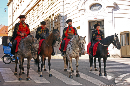 CROATIA ZAGREB, 1 OCTOBER 2017: Four horseman, members of the Cravat Regiment, in front of the old Fortress Gate, Zagreb, Croatia Editorial