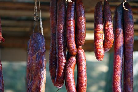 Pile of handmade smoked sausages Stock Photo