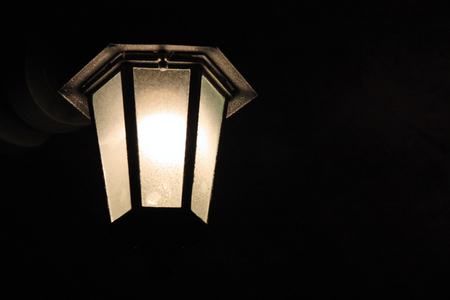 Old vintage lamp in the darkness, closeup Stock Photo