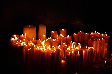 Burning candles in the darkness Stock Photo