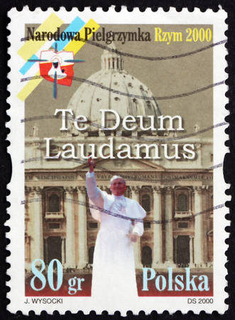 POLAND - CIRCA 2000: a stamp printed in Poland shows Pope John Paul II, and St. Peters Basilica, National Pilgrimage to Rome, circa 2000 Editorial