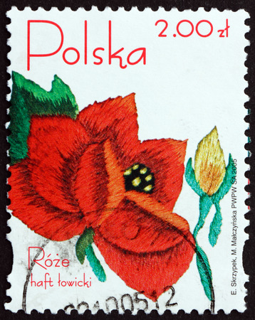 POLAND - CIRCA 2005: a stamp printed in Poland shows Embroided Rose from Lowicz Region, circa 2005 Editorial