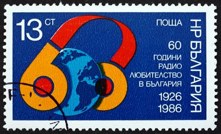 BULGARIA - CIRCA 1986: a stamp printed in Bulgaria dedicated to Home Amateur Radio Operators in Bulgaria, 60th Anniversary, circa 1986 Editorial