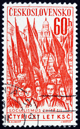 CZECHOSLOVAKIA - CIRCA 1961: a stamp printed in Czechoslovakia shows Crowd with Red Flags, circa 1961 Editorial