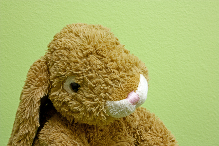 Small brown rabbit, child toy of plush Stock Photo