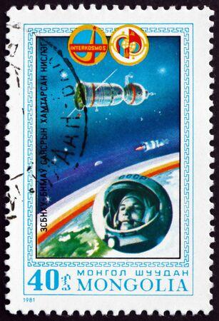 MONGOLIA - CIRCA 1981: a stamp printed in Mongolia shows Vostok I and Yuri Gagarin, Intercosmos cooperative space program, circa 1981 Редакционное