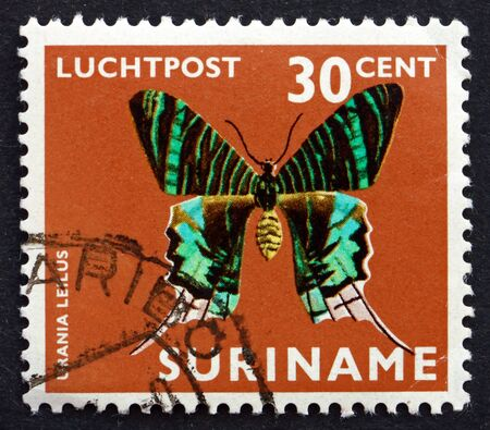 SURINAME - CIRCA 1972: a stamp printed in Suriname shows green-banded urania, urania leilus, butterfly, circa 1972