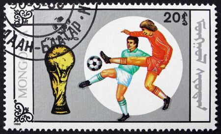MONGOLIA - CIRCA 1990: a stamp printed in Mongolia shows soccer players in action, 1990 World Cup Soccer Championships, Italy, circa 1990