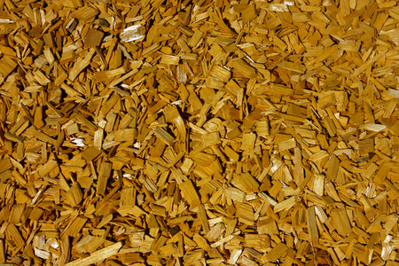 Texture of mulch. Natural background of wood chips Stock Photo