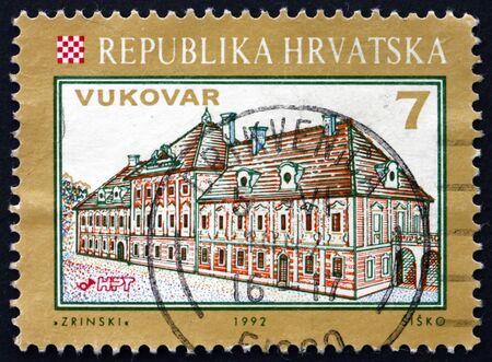 ZAGREB, CROATIA - NOVEMBER 1, 2018: a stamp printed in Croatia shows view of Eltz Castle, Vukovar, Croatian City, circa 1993 Editorial