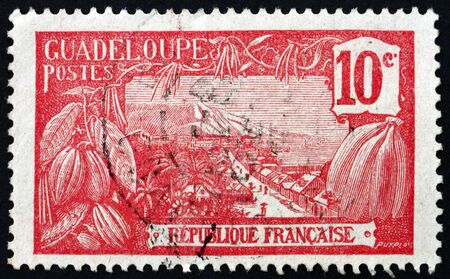 FRANCE - CIRCA 1905: a stamp printed in France shows View of Harbor at Basse-Terre, Guadeloupe, Island in the Lesser Antilles, circa 1905 Editorial
