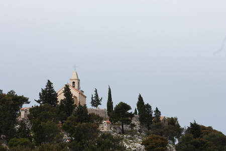 A small church on top of the hill on Mediterranean coast, Tribunj, Croatia Stock Photo