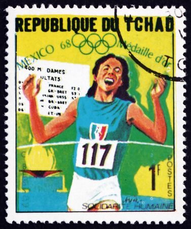 CHAD - CIRCA 1969: a stamp printed in Chad shows Colette Besson, 400m run, Winner of 1968 Olympic Games, Mexico, circa 1969