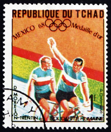 CHAD - CIRCA 1969: a stamp printed in Chad shows Daniel Morelon and Pierre Trentin, bicycle road race, tandem, Winner of 1968 Olympic Games, Mexico, circa 1969